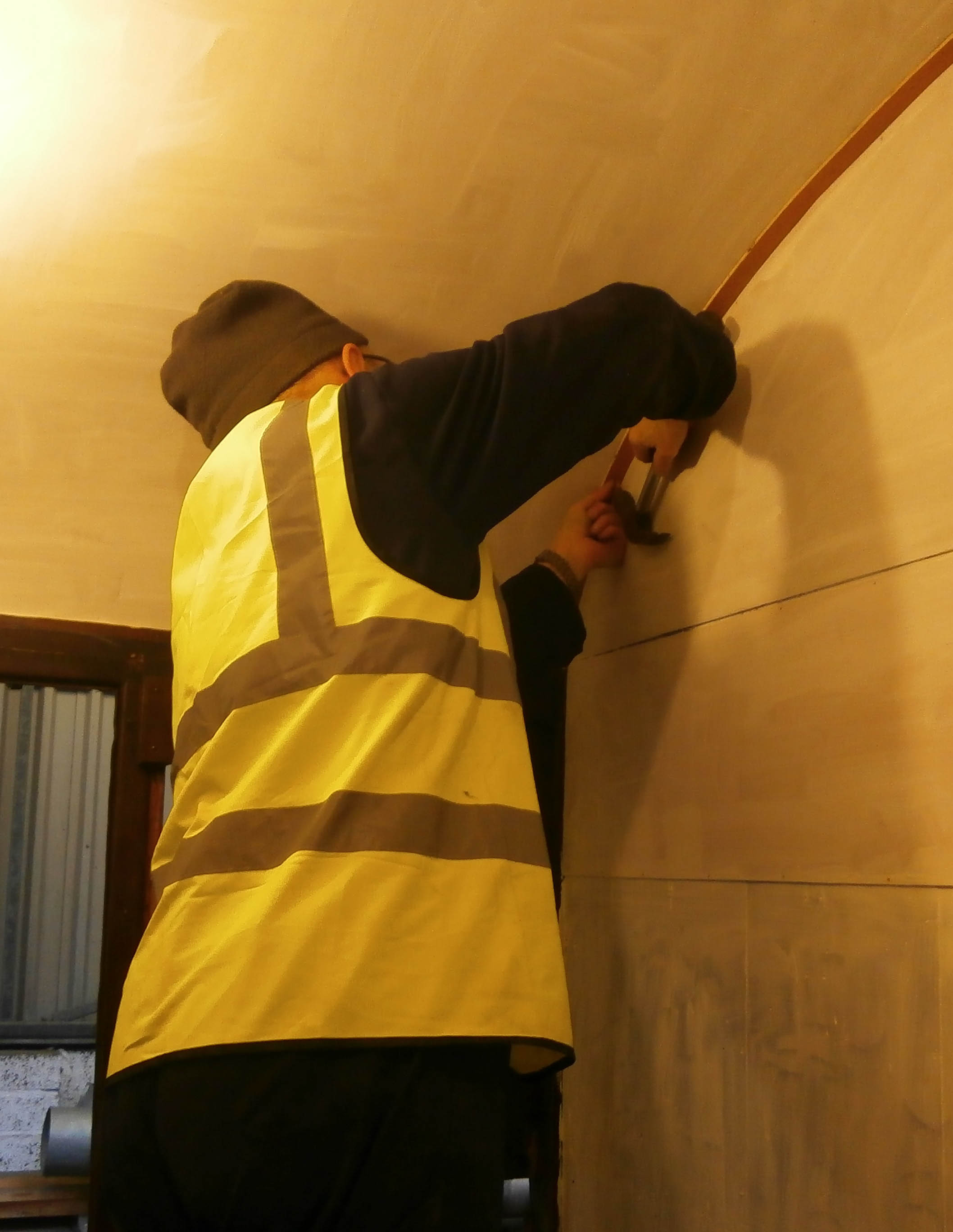 Graham Warren pins up the compartment ceiling edging