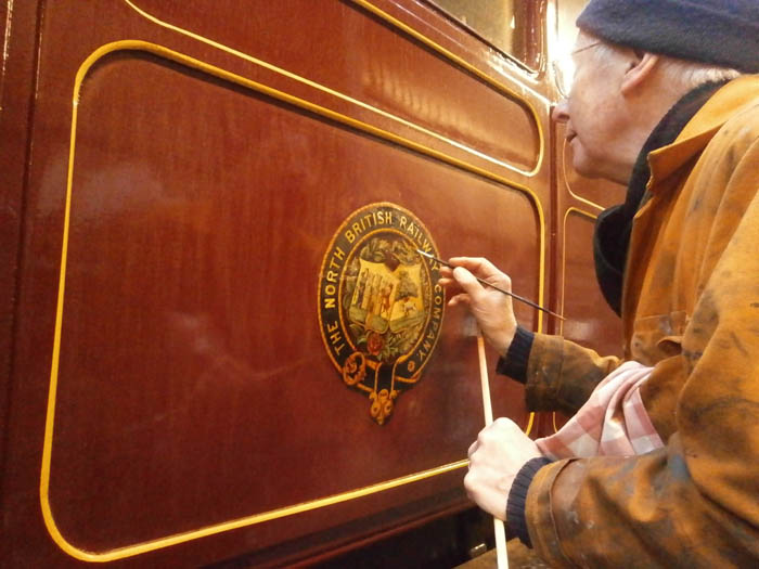 Jim painting the decal